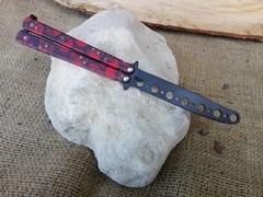 coltello butterfly TRAINER da allenamento colore rosso con teschi
